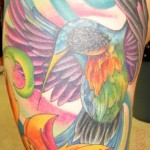 Tatouage femme cuisse colibri