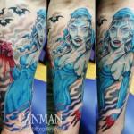 Tatouage femme cuisse femme macabre