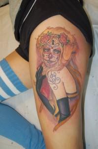 Tatouage femme cuisse fantastique