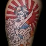 Tatouage femme cuisse japonais