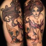 Tatouage femme cuisse sirène