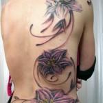 tatouage lys tribal femme